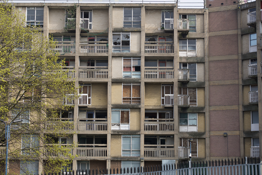 A run-down apartment building. New research shows long-term benefits of antipoverty policies in areas of concentrated poverty.