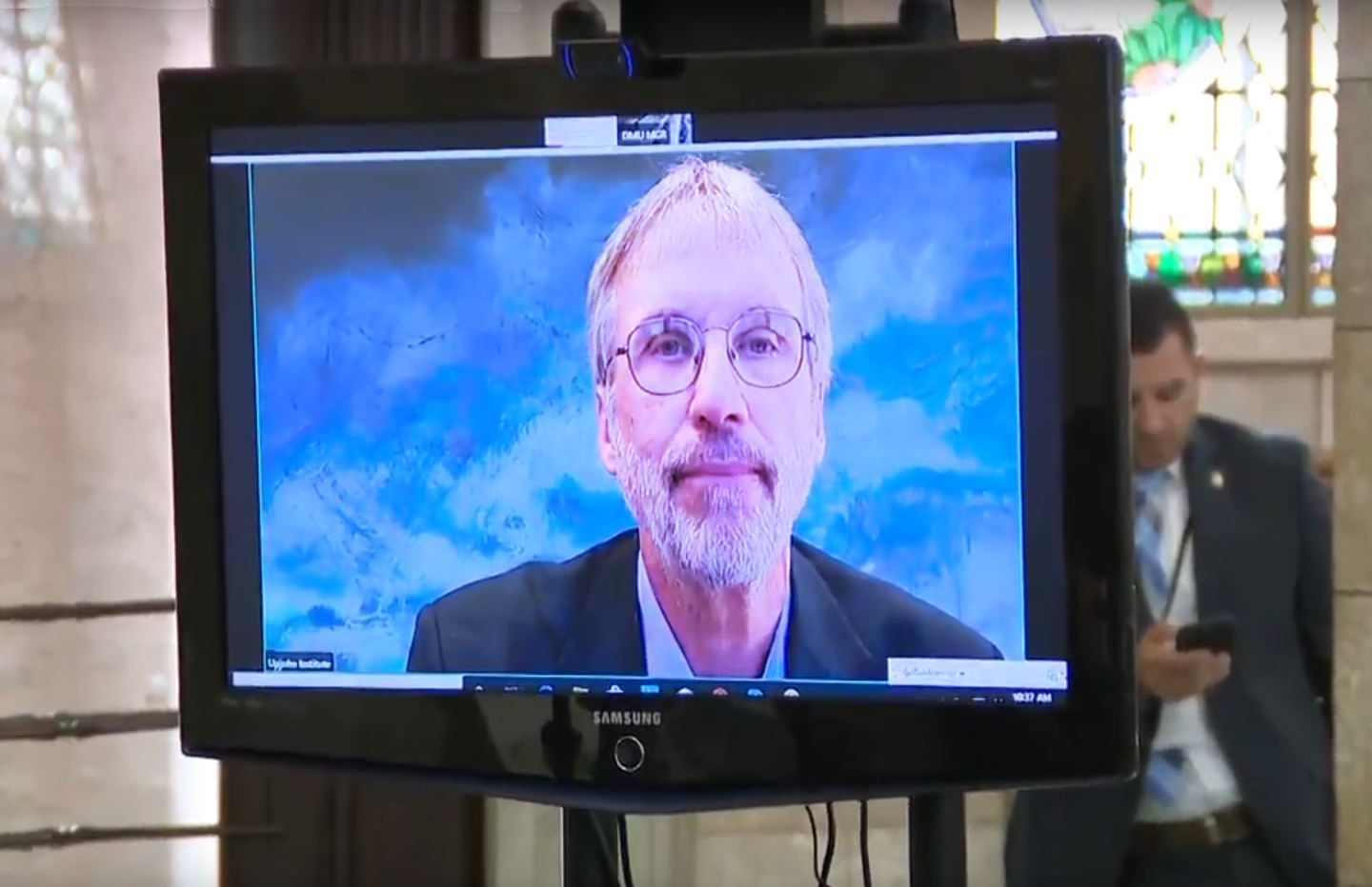 Image of Tim Bartik on a television screen in New Jersey