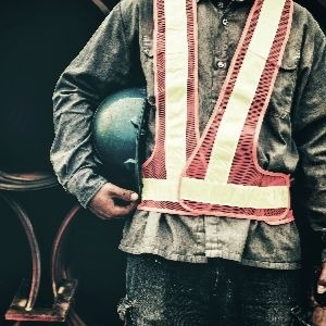 manufacturing worker in safety vest
